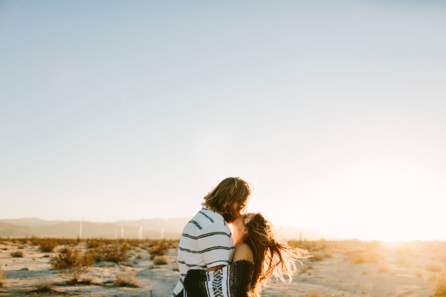 A Windy, Romantic Desert Engagement – Photo by Let's Frolic Together