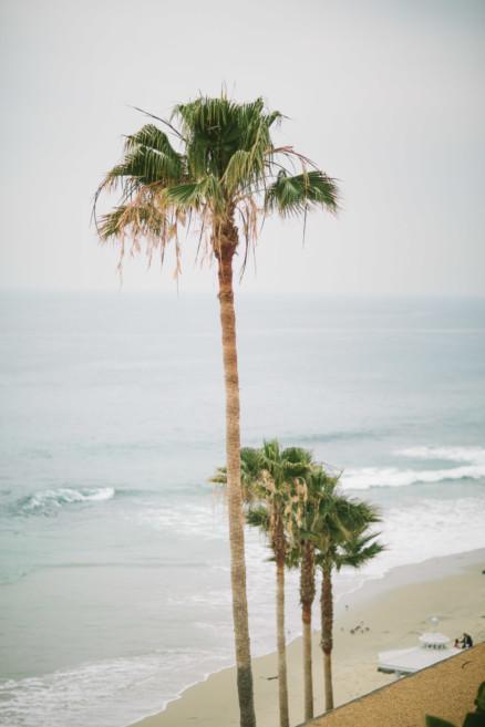 Misty Surf & Sand Resort Wedding – Photo by Let's Frolic Together